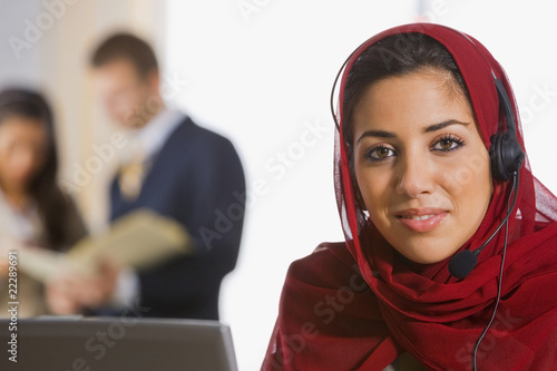 Middle Eastern businesswoman wearing headset