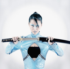 Asian woman holding samurai sword