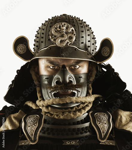 Close up of Asian man in samurai armor