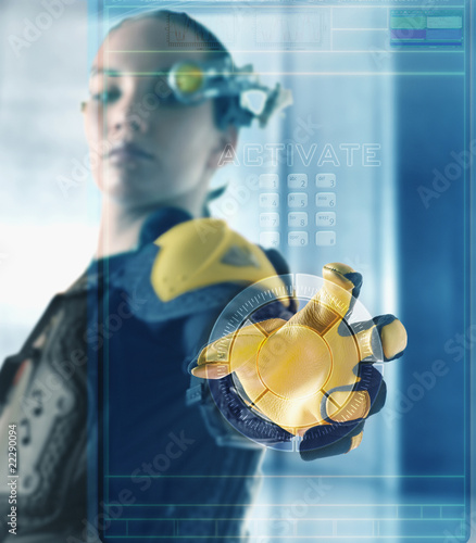 Digital composite of woman using futuristic touch screen