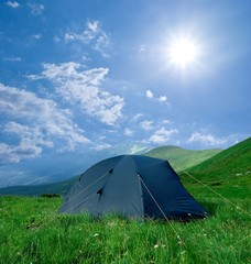 touristic tent in a green hills