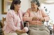 Senior Hispanic woman knitting with adult daughter