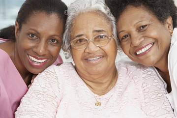 Senior African American woman with nurse and daughter