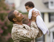 African American military father holding baby