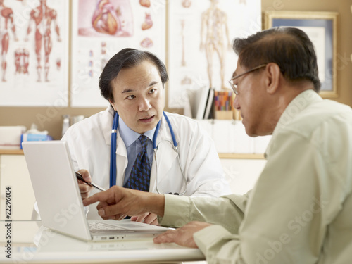 Asian male doctor talking to patient