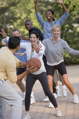Multi-ethnic friends playing basketball