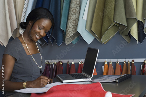 African businesswoman writing on calendar