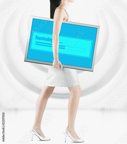 Pacific Islander woman carrying lcd screen