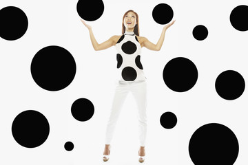 Asian woman wearing polka dot shirt