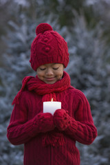 African girl holding lit candle
