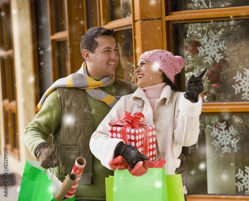 Hispanic couple Christmas shopping