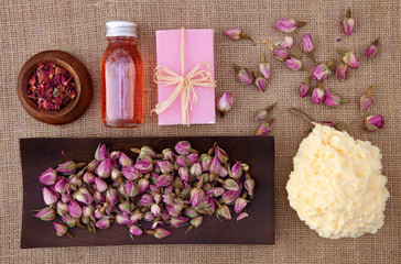 Rose petals spa on brown background