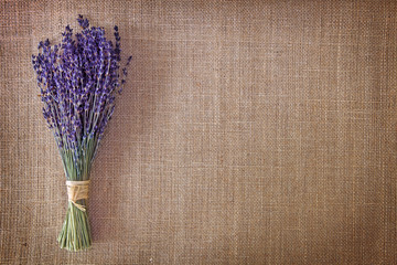 Bunch of dried lavender flowers on brown background