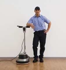 Hispanic man leaning on floor cleaner