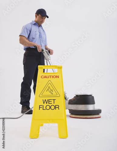 Hispanic man cleaning floor
