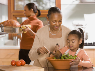 """African grandmother, mother and daughter preparing food"""