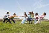 Multi-ethnic children playing tug-of-war