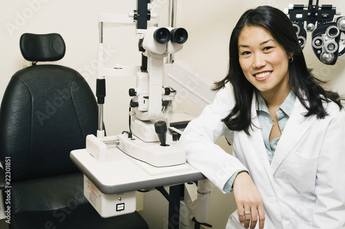 Asian female optometrist in office