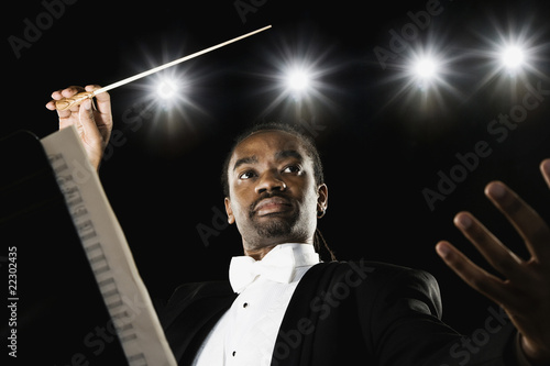 African male conductor holding baton