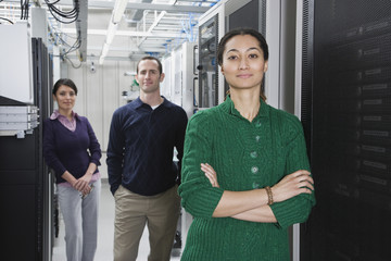 Multi-ethnic coworkers in computer server room