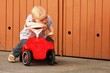 Child with  red car