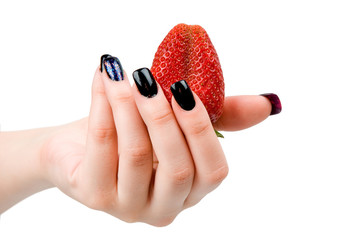 Strawberry in a female hand