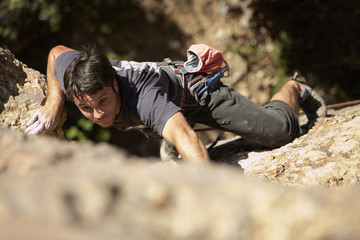 Argentinean man rock climbing
