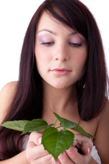 Young woman with green plant.
