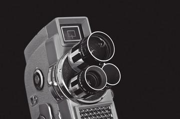 old cine camera on black