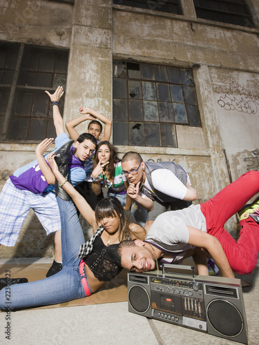 Alternative friends break dancing in urban setting