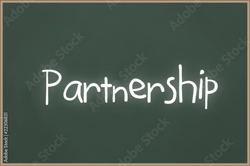 Chalkboard with text Partnership