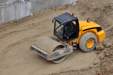 Yellow steamroller on a construction site – CONSTRUCTION