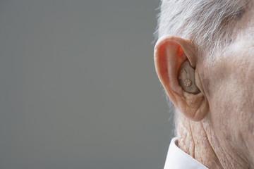 Close up of senior Hispanic manÕs hearing aid