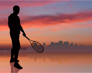 Tennis Player on Sunset Background with Skyline