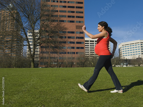 Pregnant Middle Eastern woman walking for exercise