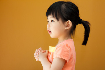 Asian baby child girl is praying