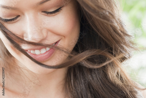 Mixed race woman looking down and smiling
