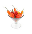 Assortment of chili hot peppers in a large martini glass