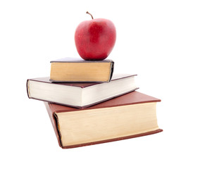 The thick books and apple on a white background