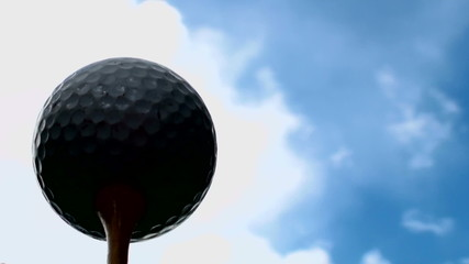 Golf ball sihouette against cloud time lapse - HD