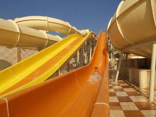 child on water slide