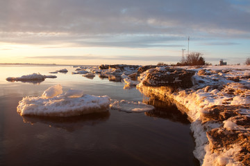 Sea on sunset in winter wih ice