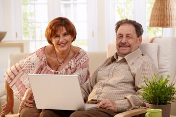 Elderly couple using laptop computer