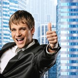 Happy businessman showing his thumb up with smile .