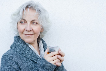 attractive mature woman with a glass of tea