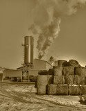 Smoke from rural refinery, sepia colored photo