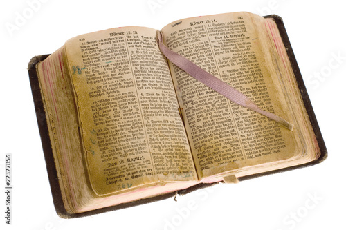 Old vintage open bible with bookmark isolated with cliping path.