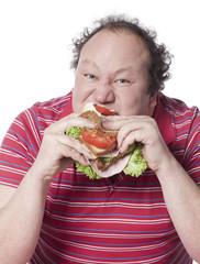 homme obèse mangeant un sandwich