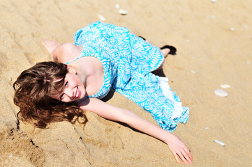 girl laying on the sand