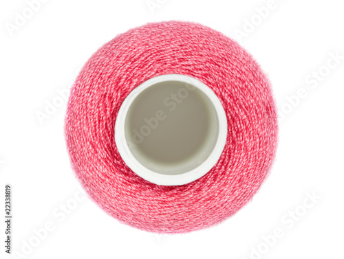 coil with red sewing threads isolated on white background